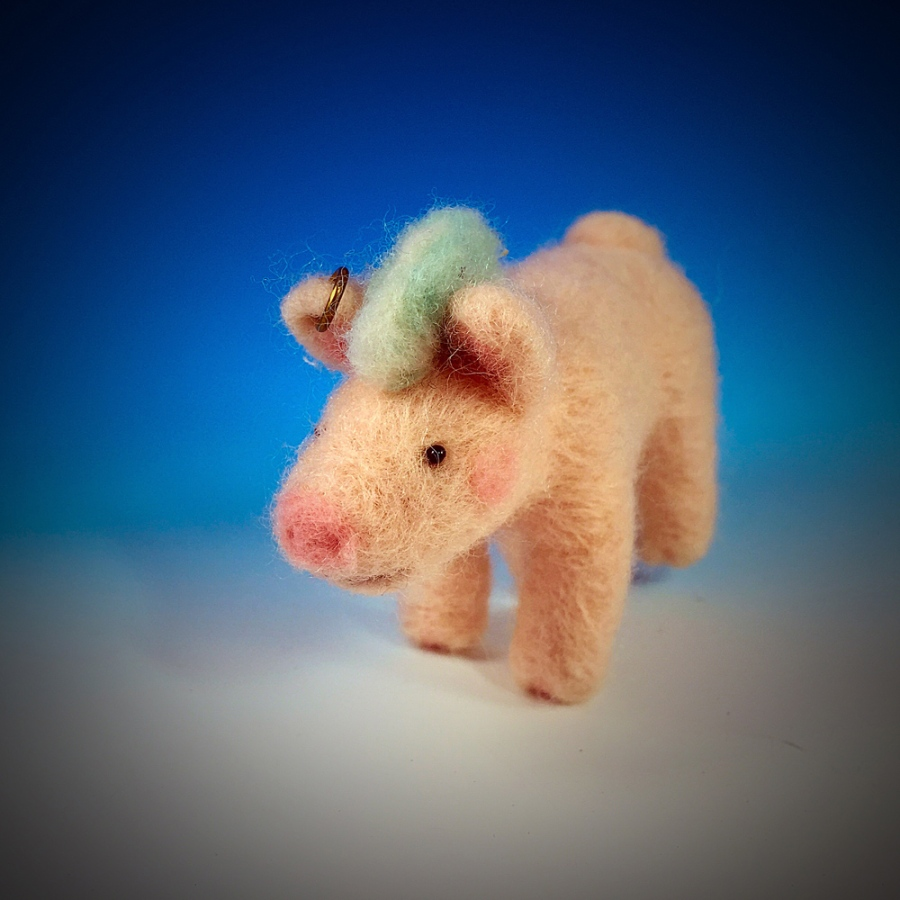 The Rocker Pig is felted out of merino wool. His earring is made of red brass.