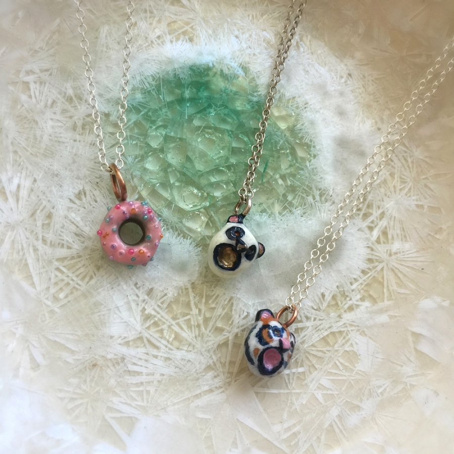 Bronze Tiger, Pink Donut, and Panda Necklaces.
