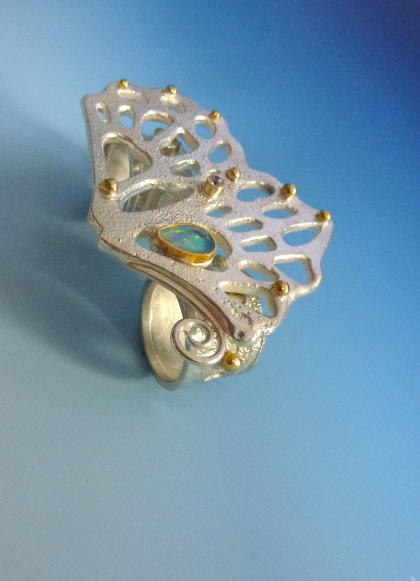 Vanishing Butterfly Ring: I made a double finger ring to match my Vanishing Butterfly Necklace. This is made of silver, gold, white sapphire and opals.