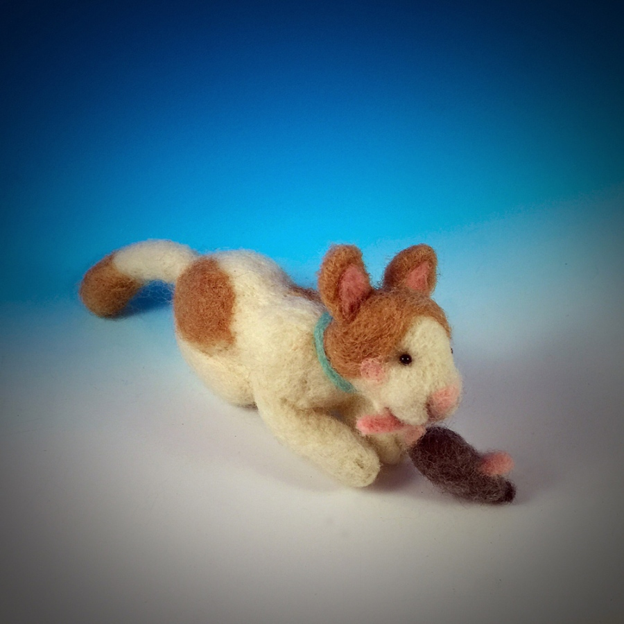 The Cat and Mouse is felted out of merino wool. His eyes are fabricated out of resin and red brass.