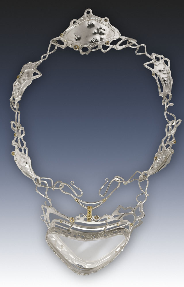 "Vulgar Transcendence: I fabricated this diadem out of sterling silver, gold, antique mine cut diamonds, and an old magnifying lens. This was a part of my MFA thesis show, ""Instruments of Vanity""."