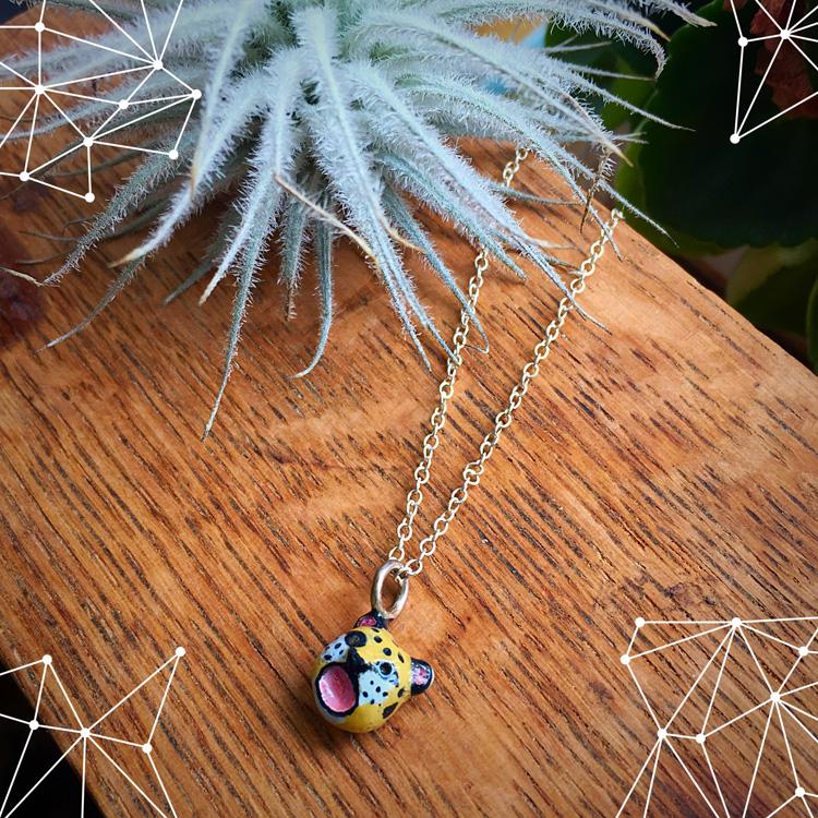 Tiny leopard bronze necklace