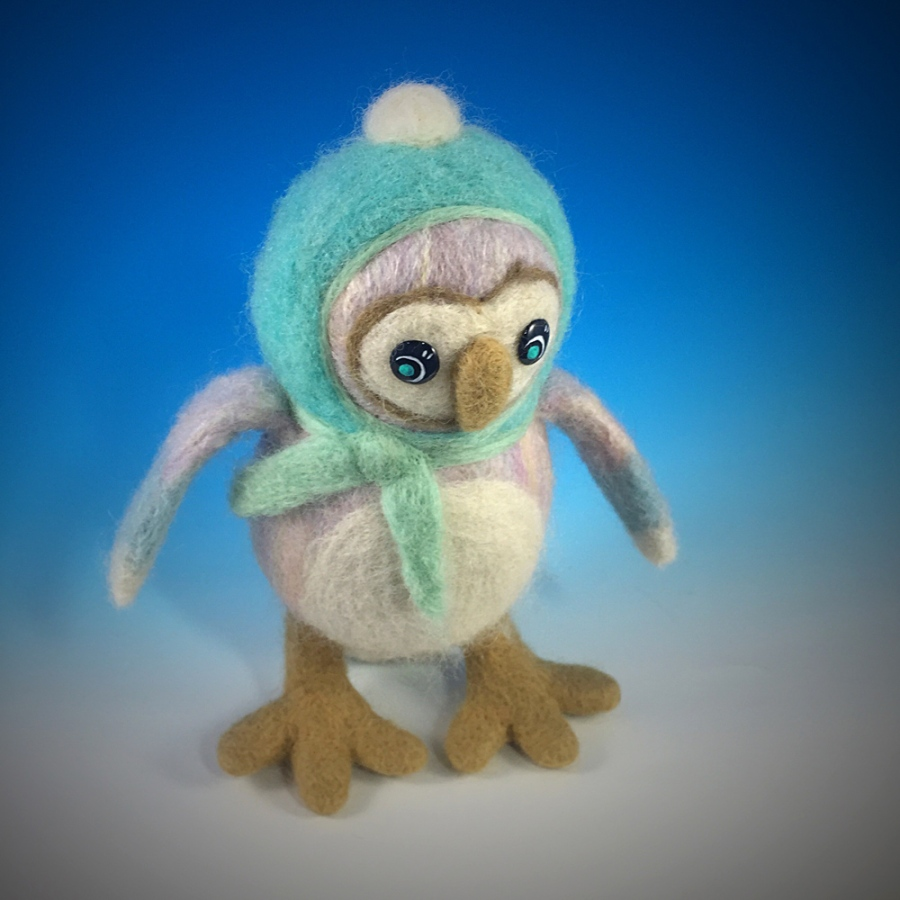 The Winter Owl is felted from Merino Wool. His eyes are made of brass and resin.
