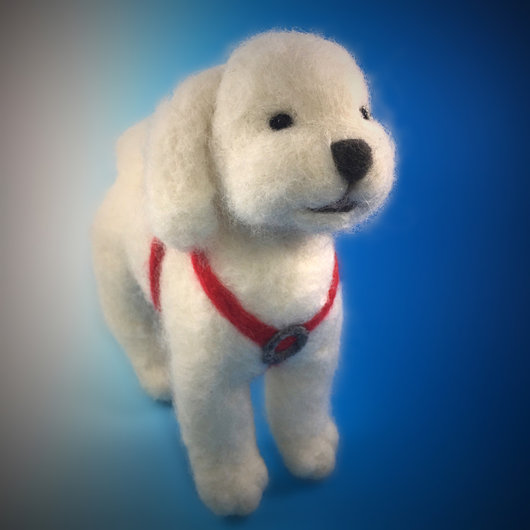I made this custom felt sculpture for a client to give a Christmas present. This was a portrait of a client's friend's bichon frise'.