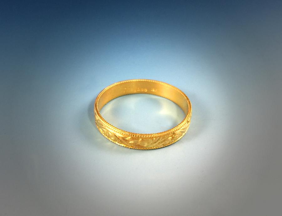 Detail image of engraved floral ring.