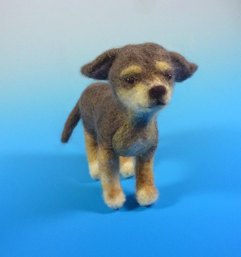 Detail image of felt dog sculpture.