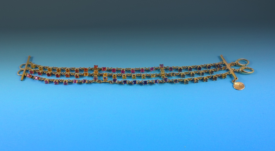 I fabricated this 14kt gold sapphire bracelet for a client that gave this as a present for his girlfriend. The bracelet is set with over 60 multicolored sapphires.
