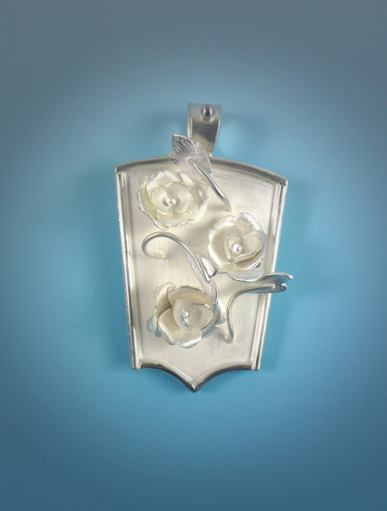 This silver rose pendant was made as a present for a client's mother.