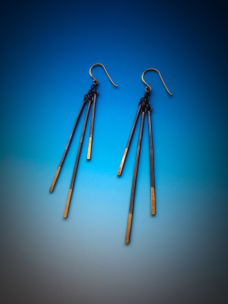 Sample of earrings with Keum-Boo. Keum-Boo is a Korean technique of fusing pure gold onto silver.