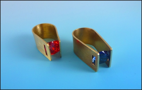 These tension set rings are also made by student, Michele Murphy. She fabricated them out of cubic zirconia and nugold.