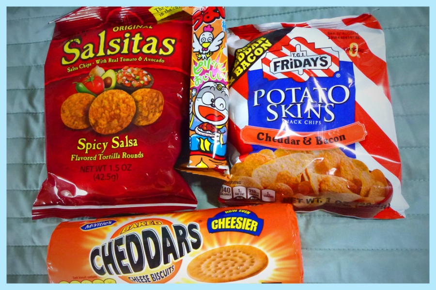 Savory snacks: Salsitas, T.G.I. Friday's Potato Skins, and McVitie's Chedders cheese biscuits.