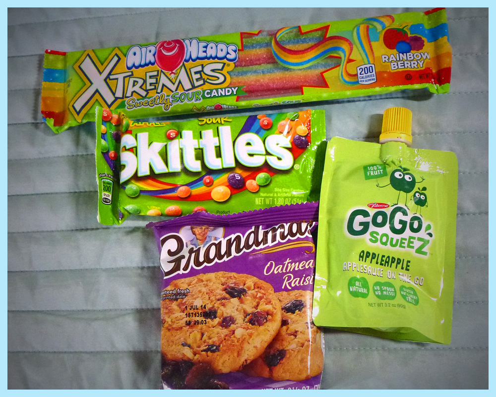 American Treats: Air Heads Extremes, Sour Skittles, Grandma's Oatmeal Raisin cookie, and Materne's GoGo Squeeze