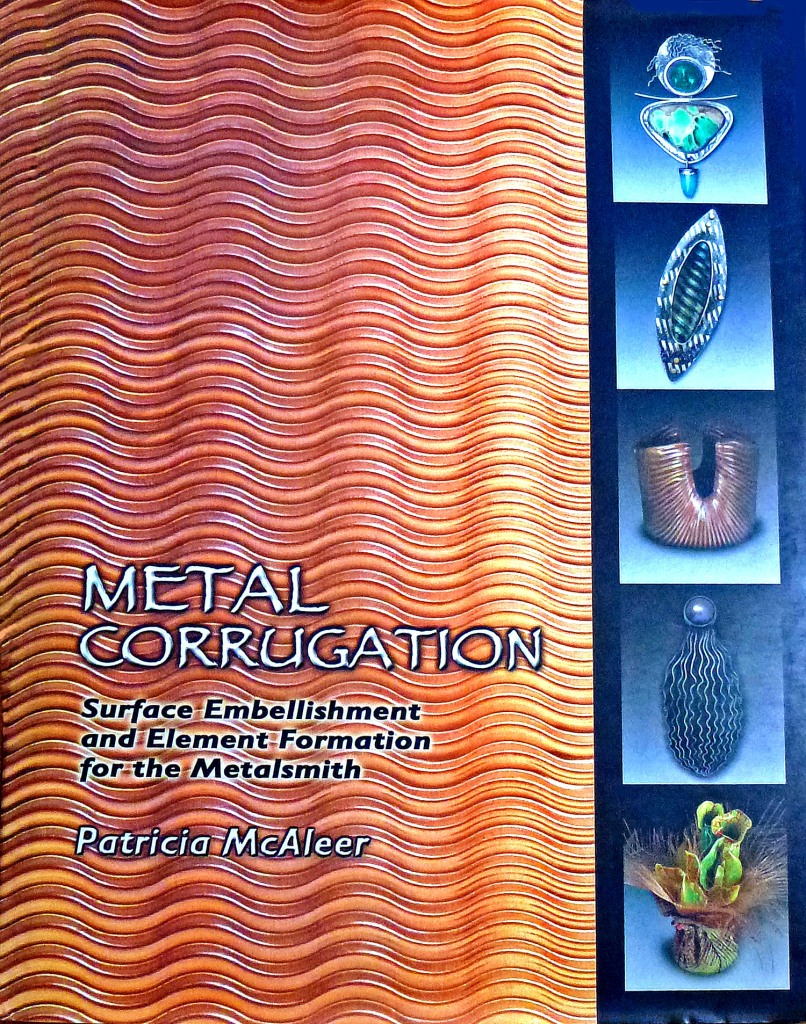 This is the cover of the book, Metal Corrugation, that features some of my jewelry work.