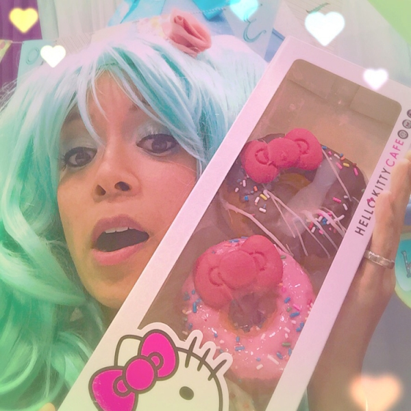 This is a very playful sea foam blue wig with double ponytails that I purchased at Comic-Con last year from Epic Cosplay. It definitely is reminiscent of the vocaloid singer, Hatsune Miku. Here, I'm displaying my ultimate prize finding from Comic-Con: Hello Kitty Donuts!