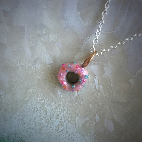 I cannot deny that I was channeling Homer Simpson when I made this pink donut necklace with rainbow sprinkles!