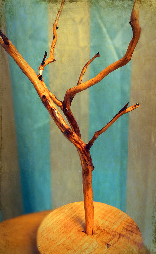 My necklace tree stand with hand carved base.